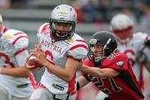 VIENNA, AUSTRIA - JUNE 9: QB Adrian Platzgummer (#6 Austria) runs with the ball on June 9, 2012 in V