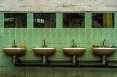 stock photo of lavabo  - Old industrial lavatory with lavabos and mirrors - JPG
