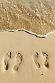 Two Pairs Footstep On The Beach