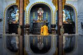 Buddhist monk praying on afternoon religion ceremony in a temple, Vietnam