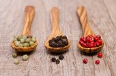 3 Various Pepper On A Wooden Spoon