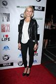 LOS ANGELES - APR 2:  Sina Henrie arrives at  the No Kill L.A. Charity Event at the Fred Segal on Ap