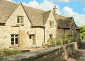 Bibury.   Cotswold stone cottages.  England, UK.