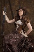 image of cowgirl  - A woman in her beautiful western dress and corset holding on to her shot gun being a real cowgirl - JPG