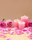 spa setting with rose and candle ,petals