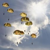 The skydivers on stormy sky.