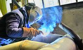 stock photo of shipyard  - a welder working at shipyard in day time - JPG