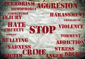 Stop violence symbol, grunge background with red letters