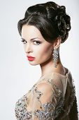 Prosperity. Luxury. Glamorous Showy Woman With Diamond Earrings