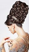 Luxury. Fashion Model With Trendy Updo - Braided Tress. Vogue Style