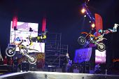 MOSCOW - MAR 02: Simultaneous jump motorcyclists on the festival extreme sports Breakthrough 2013 in the arena of the Olympic Sports Complex, on March 02, 2013 in Moscow, Russia.