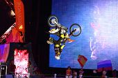 MOSCOW - MAR 02: Somersault on a motorcycle on the festival extreme sports Breakthrough 2013 in the