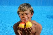 Boy With Apples At Swimming Pool