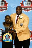 CANTON, OH-AUG 3: Former Tampa Bay Buccaneers defensive tackle Warren Sapp poses with his bust during the NFL Class of 2013 Enshrinement Ceremony at Fawcett Stadium on August 3, 2013 in Canton, Ohio.