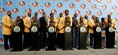 CANTON, OH-AUG 3: The NFL Class of 2013 stand with their busts during the 2013 Enshrinement Ceremony