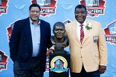 CANTON, OH-AUG 3:  David Robinson (L) poses with his father Dave Robinson with his bust during the N