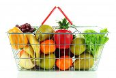 Different fruits and vegetables in metal basket isolated on white
