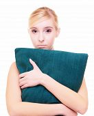 Sleepy Blond Girl With Green Pillow Isolated Over White
