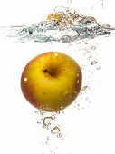 Yellow Apple In The Water Splash Over White