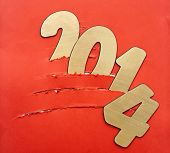 Torn paper christmas tree with two thousand fourteen New Year number decoration