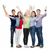 foto of waving hands  - education and people concept  - JPG