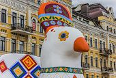 Ukrainian Painted Chicken Statue In Fron Of A Yellow Building