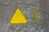 Concrete Gray Wall With Yellow Triangle