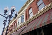 stock photo of awning  - A photo of a typical small town main street facade in the United States of America - JPG