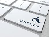 image of disability  - Adaptation Word with  Disabled Icon on Button of White Modern Computer Keyboard - JPG