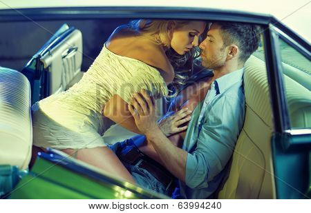 Sexy couple in the car poster