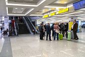 BELGRADE, SERBIA - FEBRUARY 18, 2014: Passengers  wait at Belgrade airport Nikola Tesla, the fastest growing major airport in Europe.