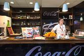 BELGRADE, SERBIA - FEBRUARY 18, 2014: Waiter stands behind bar at Belgrade airport Nikola Tesla,  th