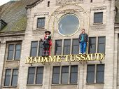 Statues On The Facade Of The Museum Madame Tussauds In Amsterdam. Netherlands