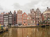 Houses On The Canal In Amsterdam . Netherlands