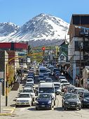 Ushuaia, Argentina, Traffic Jam On Street With Mountain Over The City.