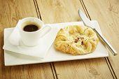 Custard Crown Pastry On White Dish