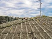 pic of asbestos  - Roof covered with asbestos cement sheets in a very bad state of repair - JPG