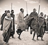 TANZANIA, AFRICA-FEBRUARY  9, 2014: Masai warriors dancing traditional jumps as cultural ceremony, r