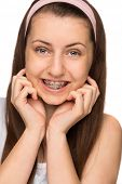 Smiling girl with braces teenager beauty on white background