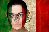 Composite image of beautiful football fan in face paint against mexico flag in grunge effect