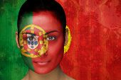 Composite image of beautiful football fan in face paint against portugal flag in grunge effect