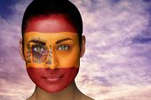 Composite image of beautiful brunette in spain facepaint against scenic landscape with blue cloudy s