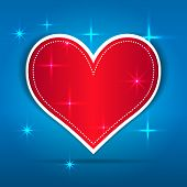 Red Paper Heart on blue background