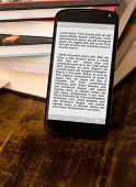 Reading ebook on smartphone. Lorem ipsum