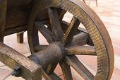 image of hand-barrow  - View of a wooden wheel of an ancient wheel barrow - JPG