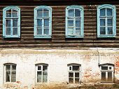 Wall Of Old Russian Urban Wooden House