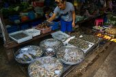 MAEKLONG, THAILAND - MARCH 24: Vendor sells fresh local fishery production on March 24, 2014 in famo