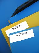 foto of payroll  - Blue and yellow folders sitting on an office tray - JPG