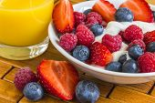Sweet Berry In Yoghurt With Orange Juice