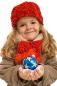 Little Girl In Warm Clothes Holding Blue Christmas Ball